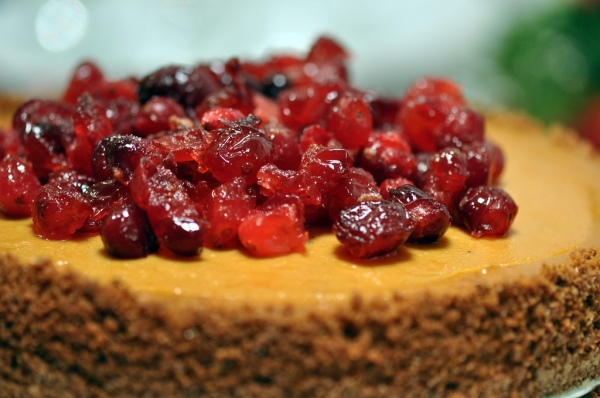 Vegan pumpkin cheesecake topped with candied cranberries