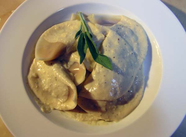 Pumpkin Agnolotti with White Bean Garlic Cream Sauce